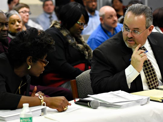 Helen Thackston Charter School Principal Denise Butts, left, confers with the school's attorney, Brian Leinhauser, as the York City School District holds a special meeting regarding the future of Helen Thackston Charter School at the Administration Building in York City, Feb. 13, 2017. Dawn J. Sagert photo