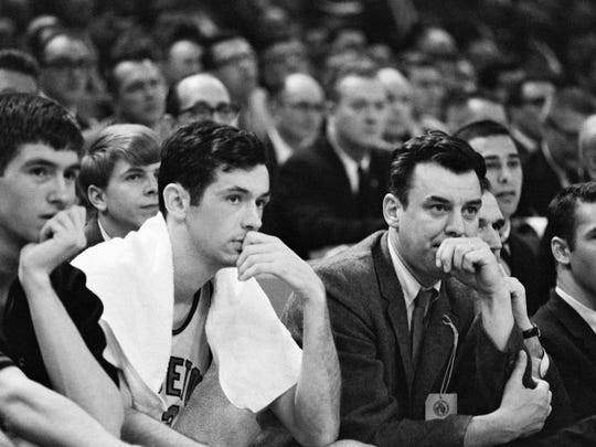Princetoncoach Bill Van Breda Kolff, right, and Bill Bradley, left, as they watch their team lose to Michigan 93-76 in the 1965 NCAA semifinals.