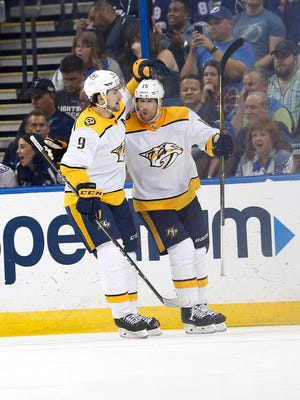 Apr 1, 2018; Tampa, FL, USA; Nashville Predators right wing Craig Smith (15) is congratulated by left wing Filip Forsberg (9) as he scored a goal during the third period at Amalie Arena. Mandatory Credit: Kim Klement-USA TODAY Sports