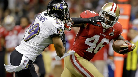 San Francisco 49ers tight end Delanie Walker, right, breaks away from Baltimore Ravens cornerback Cary Williams during the first half of Super Bowl XLVII on Feb. 3, 2013, in New Orleans.