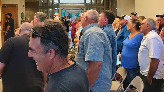 Tulare residents stood in support of farmers during Tuesday's Tulare City Council meeting.