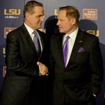 In this Jan. 14, 2015, file photo, LSU defensive coordinator Kevin Steele, left, shakes hands with LSU head coach Les Miles during a news conference in Baton Rouge. After Steele's difficult final year as defensive coordinator at Clemson, it wasn't long before he was back on another staff with Nick Saban at Alabama. So Saban counts himself among the least surprised to see Steele and his new defense thriving at LSU in advance of their matchup with the Crimson Tide.