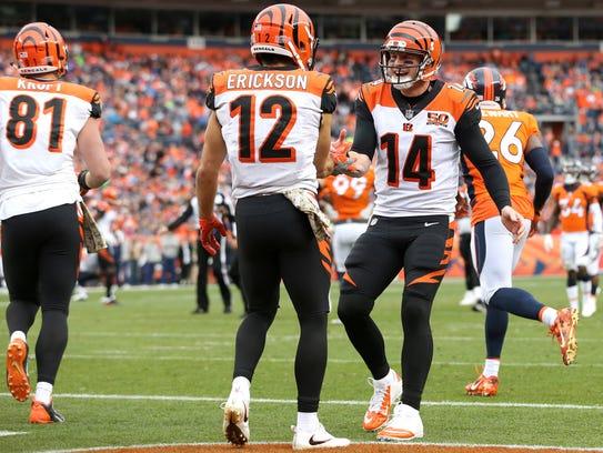 Cincinnati Bengals quarterback Andy Dalton (14) congratulates