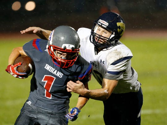 Susquehanna Valley's Jarred Freije grabs onto Owego's Zach Miner during Friday's game on September 29, 2017.