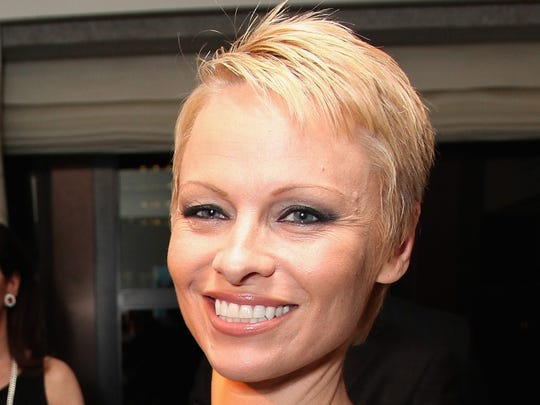 Pamela Anderson attended The Martin Katz Jewel Suite Debuts At The New York Palace Hotel on November 13, 2013 in New York City.  She is among a host of Hollywood celebs who have recently taken the plunge with a pixie cut.