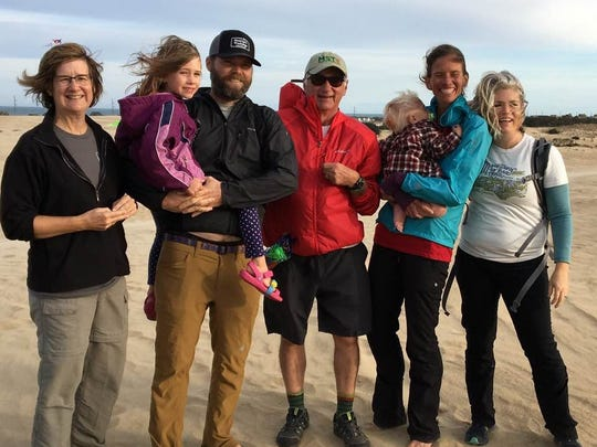 From left, Friends of MST executive director Kate Dixon, Charley Davis, Brew Davis, Steve Metcalf, Gus Davis, Jennifer Pharr Davis and Betsy Brown at Jockey's Ridge State Park.