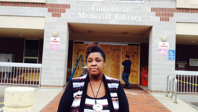 Tracy Allen, director of Finkelstein Memorial Library, describes the damage done to the Spring Valley landmark. A driver drove his Toyota SUV through the doors and crashed into the large front desk, injuring patrons and hospitalizing  one girl,15, who ended up underneath the vehicle.