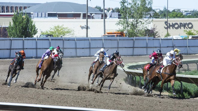 Horses turn into the home stretch during the second day of the Great Falls Race Meet at the Montana Expo Park on Sunday. Racing continues next weekend.