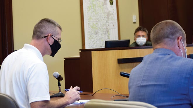 Leavenworth County Health Officer Jamie Miller, left, speaks Wednesday during a meeting of the County Commission. Also pictured is Commissioner Jeff Culbertson and Senior County Counselor David Van Parys.