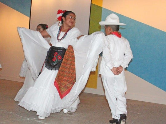 """Dancers with RAICES show off Hispanic culture at CoThinkk's """"Connecting Through The Roots,"""" an Oct. 22 event at the Asheville Art Museum where the giving circle issued $4,500 in grants and honored community leaders of color."""