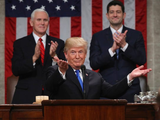 President Donald Trump gestures as delivers his first