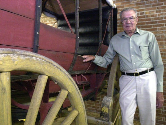 Bill Tonkovich poses with a stagecoach in Great Falls