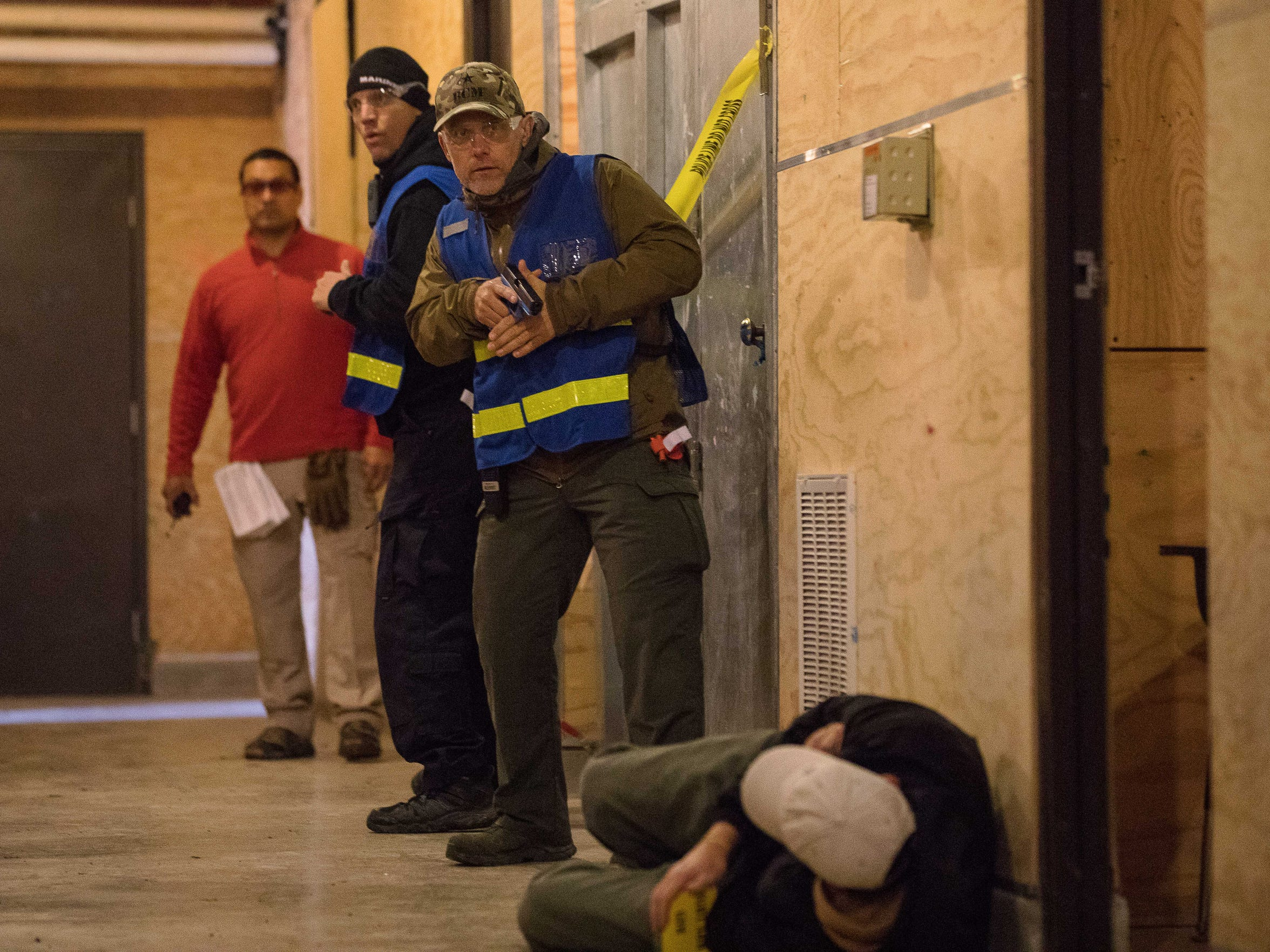Police officers clear a hallway as they take part in active shooter training conducted by Advanced Law Enforcement Rapid Response Training: Center in Maxwell, Texas on Feb. 14, 2018.