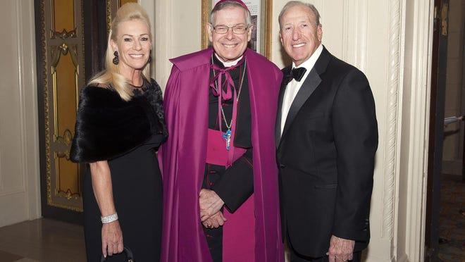 Lynda Lomangino, Bishop Gerald Barbarito and Anthony Lomangino at the Caritas Dei Bishop's Gala at The Breakers on Jan. 22.  [MEGHAN MCCARTHY/PALMBEACHDAILYNEWS.COM]]