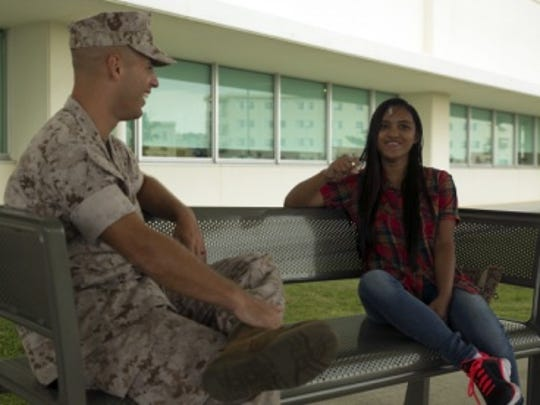 Cpl. Daniel J. Benjamin Jr. reunites with Paula Genova at U.S. Naval Hospital Okinawa, Camp Foster, Okinawa, Japan, on Sept. 14, two weeks after being credited with saving her life from a substantial head injury. On Aug. 31, Genova was riding her bike when she lost control and was struck in the head by a tree branch. While losing a significant amount of blood and screaming for help, Benjamin came to her aid by taking her straight to the hospital.