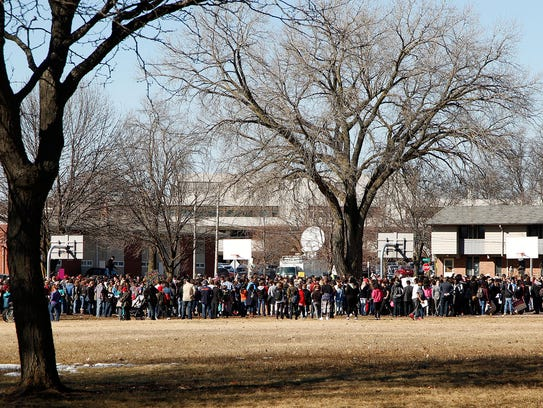 Protesters gather for a rally at Worthington Park in