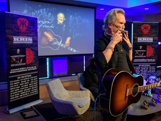Kris Kristofferson sings at the press conference regarding