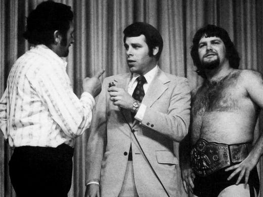 Wrestling announcer Dave Brown in middle, wrestler