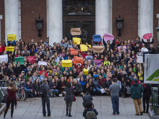 Protesters gather for a group photo at the Waterman Building at UVM in Burlington on Friday, after a demonstration in solidarity with the students at the University of Missouri, and to protest racism locally.
