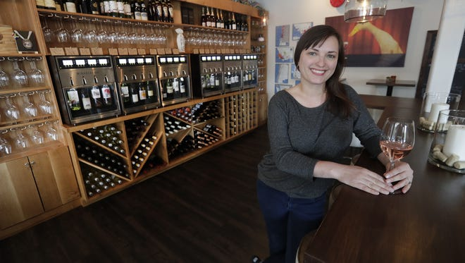 Lee-Ann Klingsporn, pictured, and her husband Brad own Aardvark Wine Lounge , 304 Pine Street in Green Bay. The couple have been key proponents of a measure to allow sidewalk seating at Green Bay bars and restaurants.