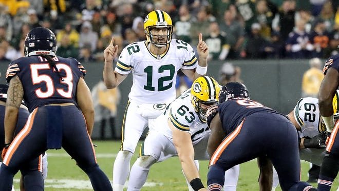 Green Bay Packers quarterback Aaron Rodgers (12) gestures at the line Thursday, September 28, 2017 against the Chicago Bears at Lambeau Field in Green Bay, Wis.