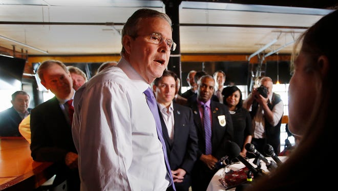 Former Florida Gov. Jeb Bush speaks at the Draft restaurant, Thursday, May 21, 2015, in Concord, N.H. Bush is visiting the nation's earliest presidential primary state as he considers a run for the Republican nomination for president. (AP Photo/Jim Cole)