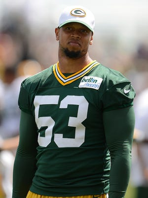 Green Bay Packers linebacker Nick Perry looks on during training camp practice at Ray Nitschke Field on Tuesday, Aug. 11, 2015.