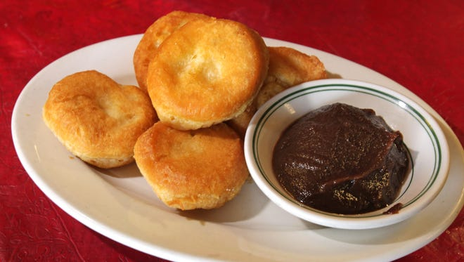 FILE -- Fried biscuits served with apple butter