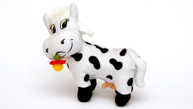 Police say a stuffed cow may have saved a two-year-old when he fell out a window.