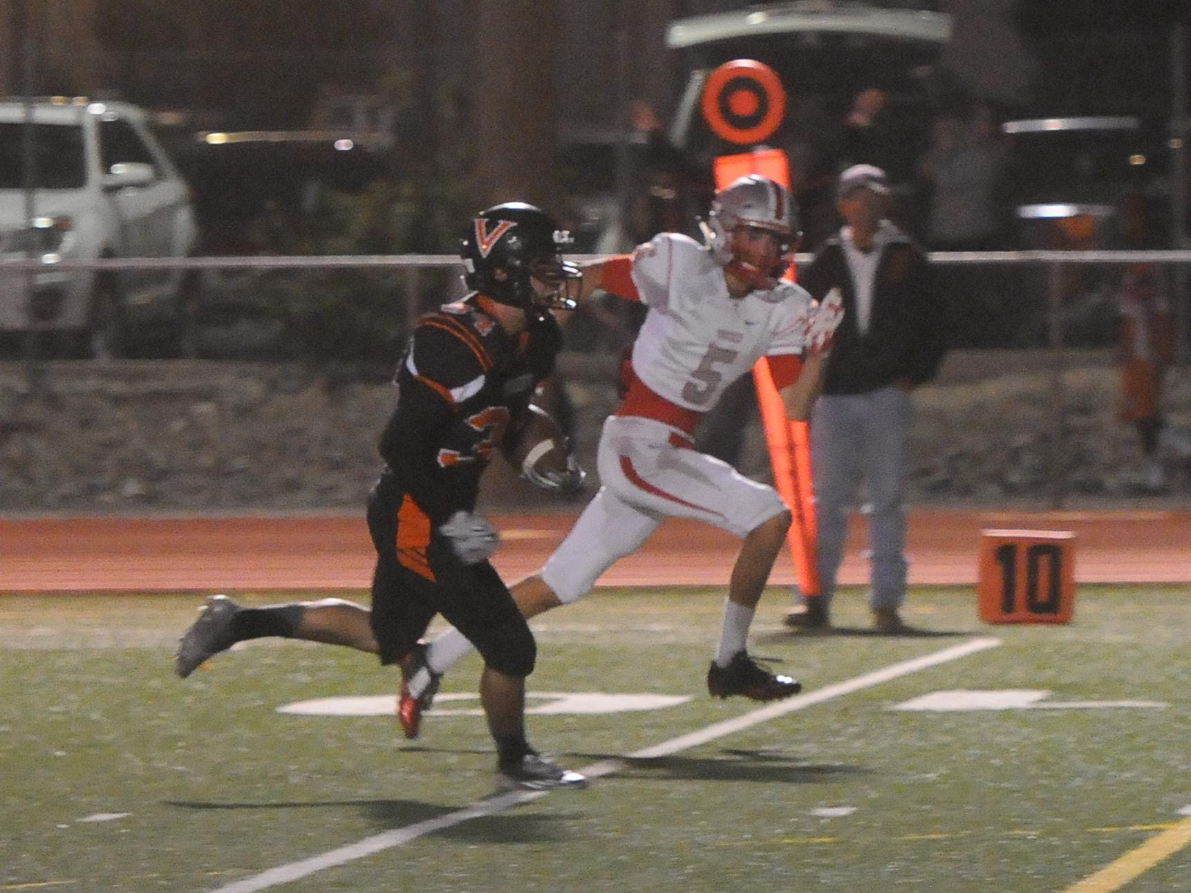 Fernley's Matt Taylor runs for the go-ahead touchdown in the Vaqueros' 28-14 win over Truckee on Friday.