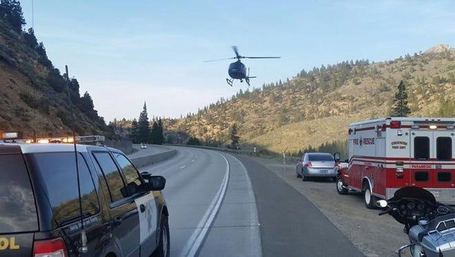 First responders on the scene along Interstate 80 west of Reno on Sunday after a 13-year-old boy died when struck by a train near Farad Interstate 80.
