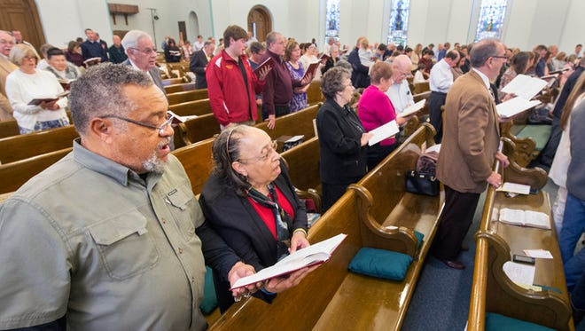 Leroy and Virginia Hunter worship at First Presbyterian Church. Faith Presbyterian, a black church, merged with First Pres on Christmas Eve in 1965.