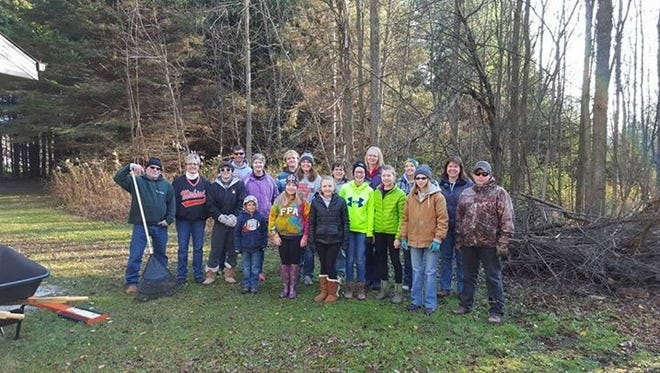 Mishicot students and community members work on the Ice Age Trail with the US Fish and Wildlife Service during a fall clean up last year. The district recently registered a new forest with the Wisconsin School Forest program.
