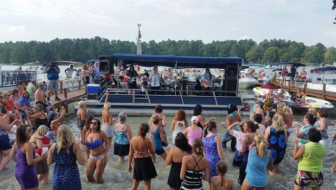 Onlookers take in a Sunday band performance at Clear Water Harbor on the Chain O' Lakes.