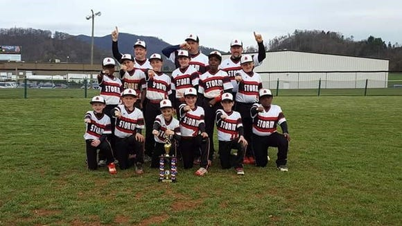 The Asheville Storm 10 and under baseball team and coaches.