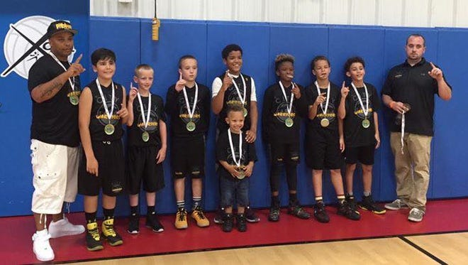 The WNC Warriors fifth-grade basketball team and coaches.