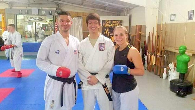From left, are Sensai Chad Petty, Adrian Galvan and Jenna Brown.