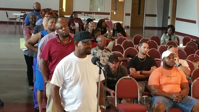 A line forms to ask child support related questions to a panel of representatives from Maximus- the company that has a contract to administer child support, Shelby County Child Support Services, Juvenile Court, Department of Human Services and Youth Dimensions- a family counseling service.