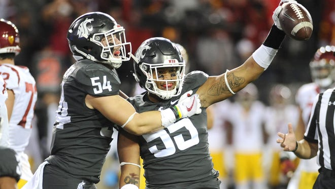 Washington State linebacker Derek Moore celebrates a fumble recovery during a win over USC.
