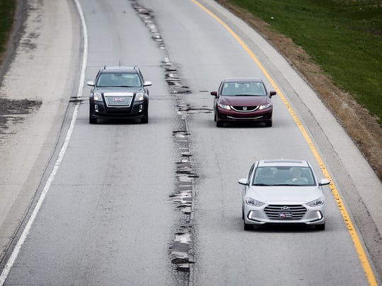 Potholes riddle a section of I-69 near Daleville Tuesday morning.