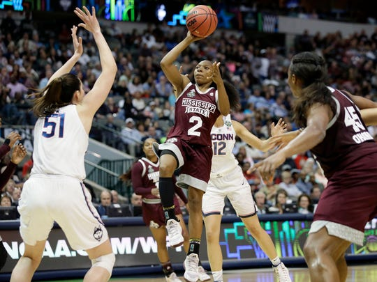 Mississippi State guard Morgan William (2) drives to the basket as Connecticut center Natalie Butler (51) defends.