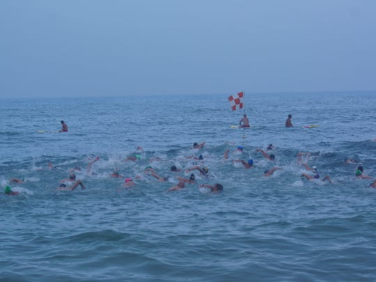 Swimmers compete during 2016's Capt. Robert S. Craig Boardwalk Swim under the watchful eyes of the Ocean City Beach Patrol.