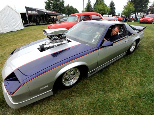 Scot Poore, 47, of Monroe, parks his 1984 Pro-Engineered  Z-28 Camaro with a 460 cubic-inch Big Block Chevy engine and an 871 Weiand Blower.  (Todd McInturf, The Detroit News)2017.