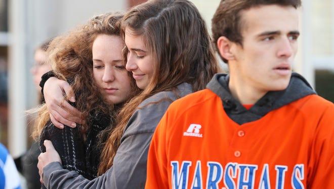 Two students hug after a prayer circle at Paducah Tilghman High School on Wednesday morning.  The students gathered to pray for the students of Marshall County High School students who were killed and injured during the shooting on Tuesday morning.