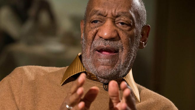 """In this Nov. 6, 2014, file photo, entertainer Bill Cosby gestures during an interview about the upcoming exhibit, """"Conversations: African and African-American Artworks in Dialogue, """" at the Smithsonian's National Museum of African Art, in Washington."""