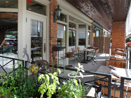 Potted herbs decorate the patio at Oakley's Bistro,