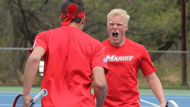 A pair of Red Foxes, including Dylan Fletcher, right, celebrate during Marist College's men's tennis MAAC championship match against Monmouth.