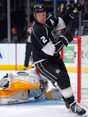 Los Angeles Kings defenseman Matt Greene, right, celebrates after scoring on Florida Panthers goalie Roberto Luongo during the second period of an NHL hockey game, Tuesday, Nov. 18, 2014, in Los Angeles. (AP Photo/Mark J. Terrill)