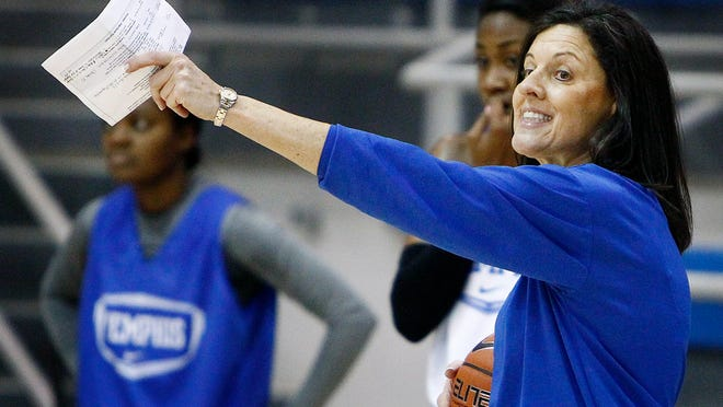 November 6, 2013 - Memphis women's head basketball coach Melissa McFerrin works with the Lady Tigers during a practice.
