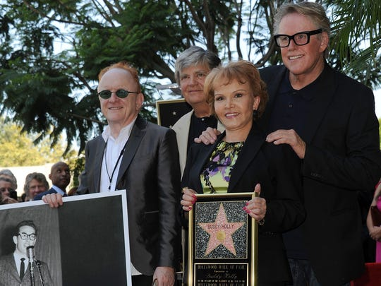 (L-R):  Peter Asher, Phil Everly, Maria Elena Holly and Gary Busey attend the Buddy Holly Hollywood Walk Of Fame Induction Ceremony in Hollywood, California September 7, 2011.